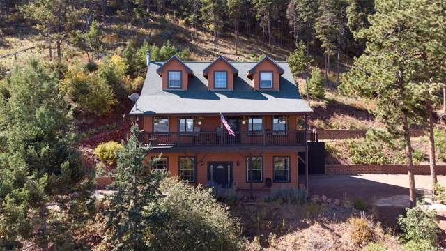 13558 Woodmoor West Drive, Larkspur, CO 80118 (#2350970) :: Mile High Luxury Real Estate