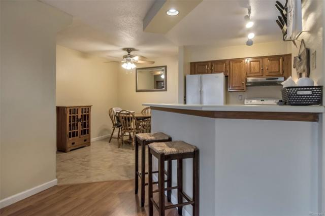12093 W Cross Drive #304, Littleton, CO 80127 (#2357909) :: The Griffith Home Team