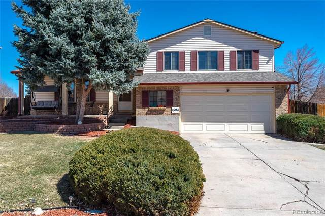 1594 S Dawson Street, Aurora, CO 80012 (#2386978) :: Bring Home Denver with Keller Williams Downtown Realty LLC