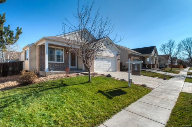 9946 Helena Street, Commerce City, CO 80022 (#2402808) :: The Peak Properties Group