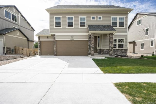 11520 E 118th Avenue, Commerce City, CO 80640 (#2459571) :: Compass Colorado Realty