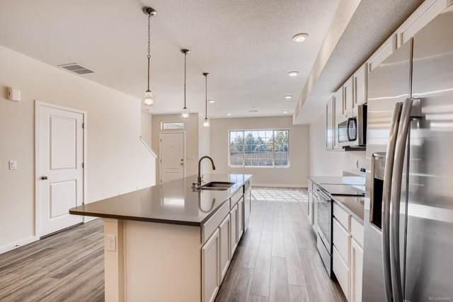 865 E 98th Avenue #904, Thornton, CO 80229 (#2459611) :: The Healey Group