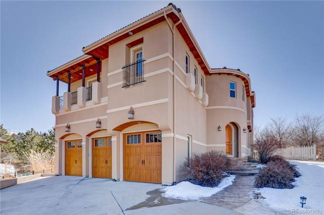 10952 W Indore Drive, Littleton, CO 80127 (#2485195) :: Portenga Properties