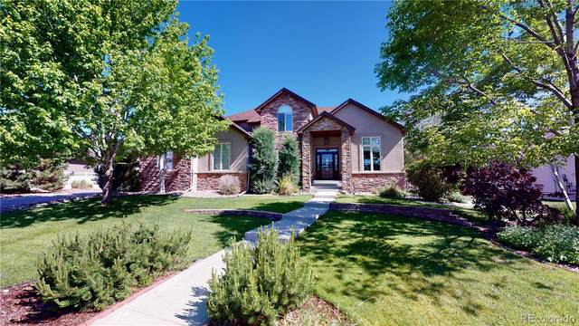 14937 W 54th Drive, Golden, CO 80403 (#2535563) :: The HomeSmiths Team - Keller Williams