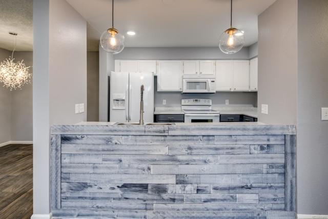 14896 E 2nd Avenue 300H, Aurora, CO 80011 (#2577990) :: The Griffith Home Team
