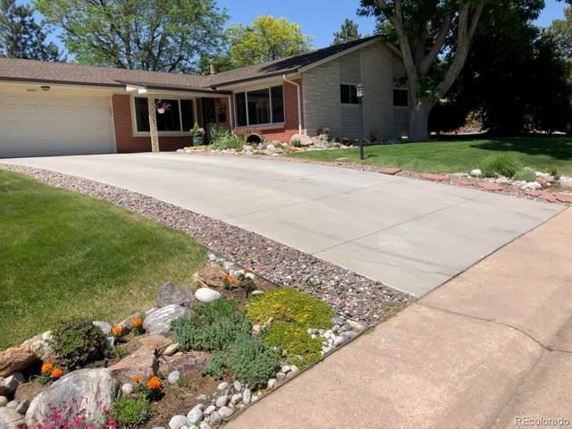 6977 S Madison Way, Centennial, CO 80122 (#2612828) :: iHomes Colorado