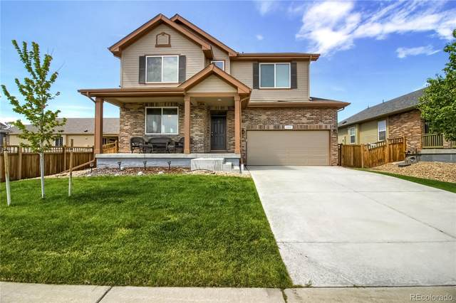 19407 E 62nd Avenue, Aurora, CO 80019 (#2667470) :: Bring Home Denver with Keller Williams Downtown Realty LLC