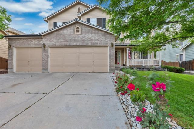 11311 Oswego Street, Commerce City, CO 80640 (#2693488) :: The Tamborra Team