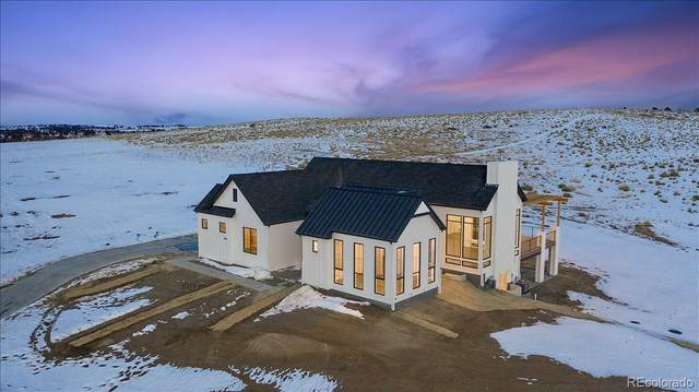 8765 Canyon Wind Street, Parker, CO 80138 (#2711932) :: The Artisan Group at Keller Williams Premier Realty