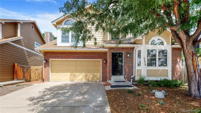 12459 W 84th Drive, Arvada, CO 80005 (#2721029) :: Bring Home Denver with Keller Williams Downtown Realty LLC
