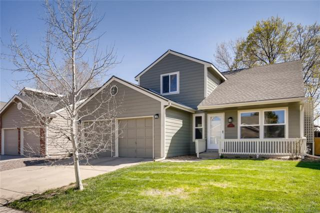 9880 W 82nd Place, Arvada, CO 80005 (#2761417) :: The Griffith Home Team