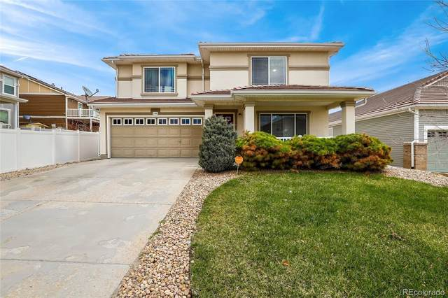 5380 Liverpool Street, Denver, CO 80249 (#2840602) :: The DeGrood Team