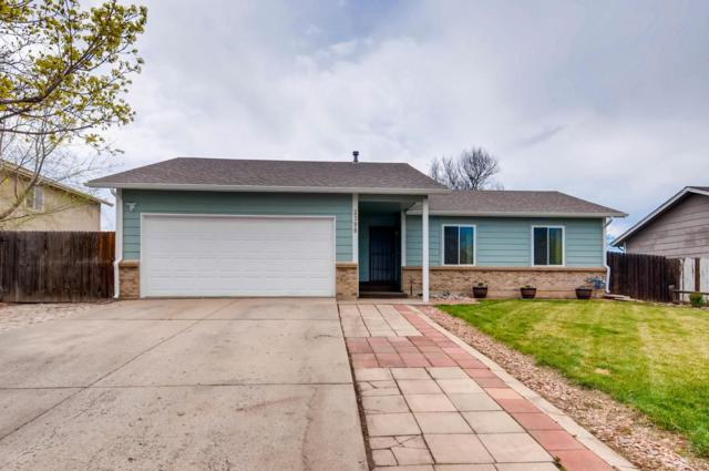 2399 Granby Way, Aurora, CO 80011 (#2861691) :: The Pete Cook Home Group