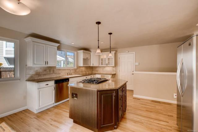 8225 Holland Court, Arvada, CO 80005 (#2893610) :: My Home Team
