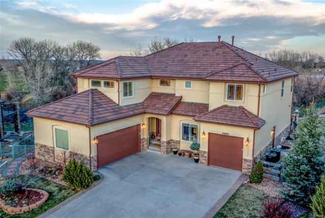 6682 Violet Way, Arvada, CO 80007 (#2897823) :: The Pete Cook Home Group