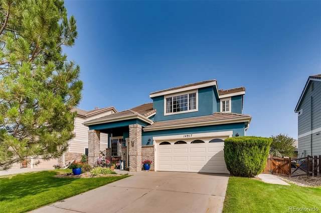 14917 E 116th Drive, Commerce City, CO 80603 (#2929738) :: Peak Properties Group