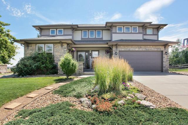 19454 W 56th Place, Golden, CO 80403 (#2948425) :: The Tamborra Team