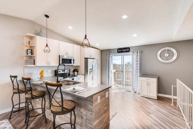 5796 W 74 Place, Arvada, CO 80003 (#2964395) :: The Griffith Home Team