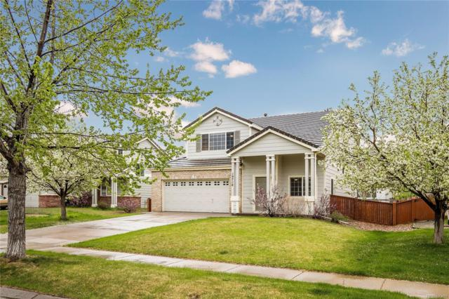 19718 E 59th Place, Aurora, CO 80019 (#3004726) :: The Pete Cook Home Group