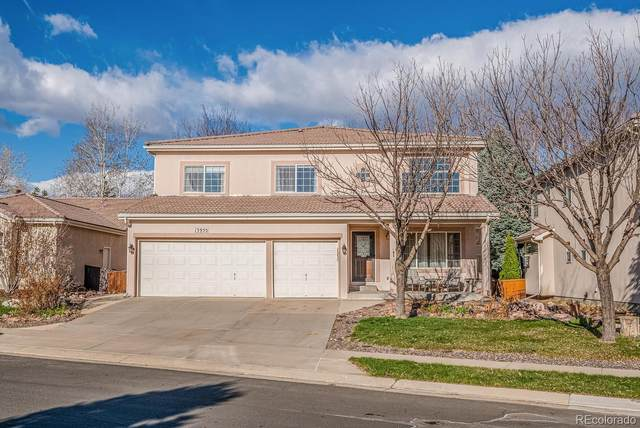 13955 Sandtrap Circle, Broomfield, CO 80023 (#3016482) :: The Healey Group