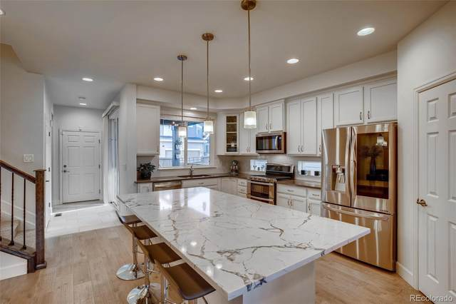 7188 W Adriatic Circle, Lakewood, CO 80227 (#3031555) :: The Brokerage Group