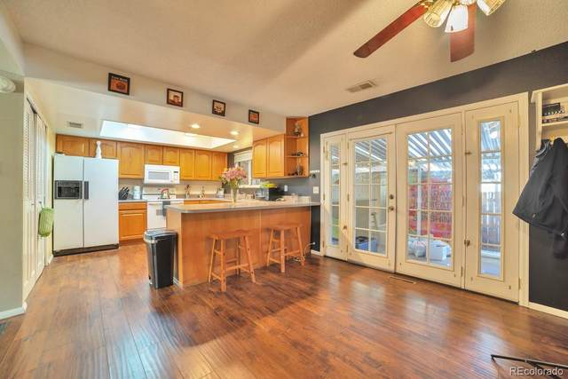 9025 E Mansfield Avenue, Denver, CO 80237 (#3048115) :: The Healey Group