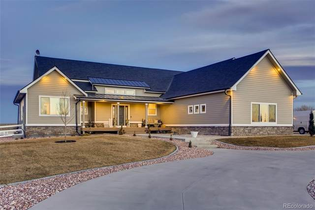 9440 Meadow Farms Drive, Milliken, CO 80543 (#3058769) :: The HomeSmiths Team - Keller Williams