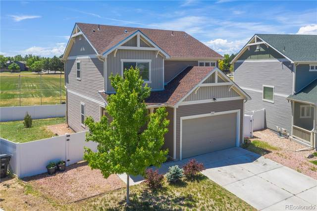 4712 Dunkirk Street, Denver, CO 80249 (#3072323) :: Peak Properties Group