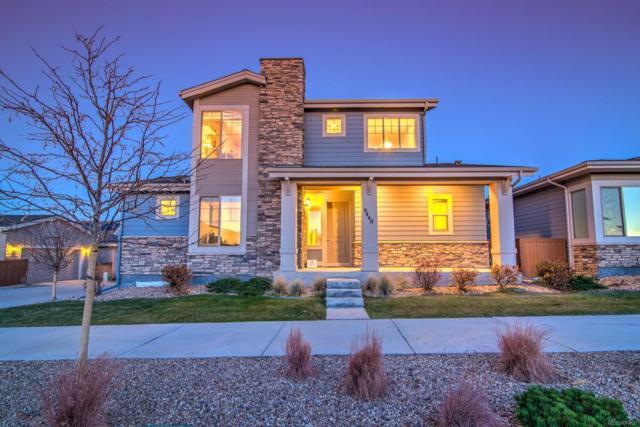 9440 Mcintyre Street, Arvada, CO 80007 (#3092597) :: Bring Home Denver