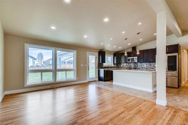 7620 S Sheridan Court, Littleton, CO 80128 (#3121540) :: The DeGrood Team