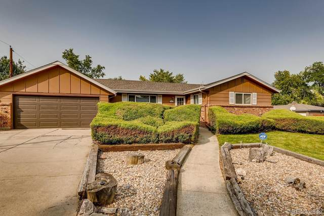 12115 W 61st Avenue, Arvada, CO 80004 (#3142046) :: Chateaux Realty Group