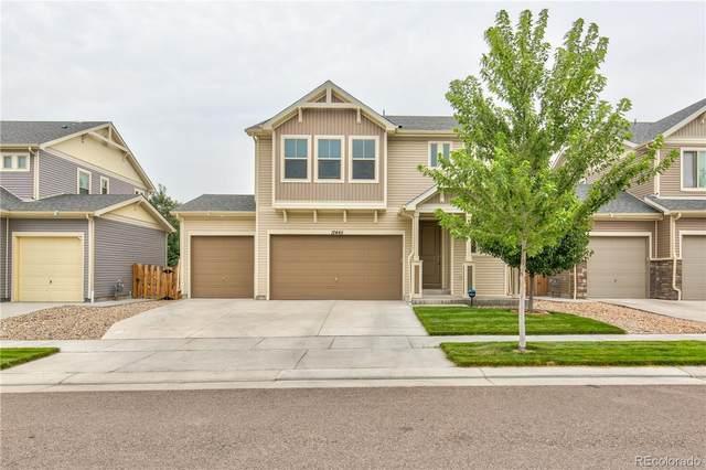 12445 E 105th Way, Commerce City, CO 80022 (#3163747) :: Symbio Denver