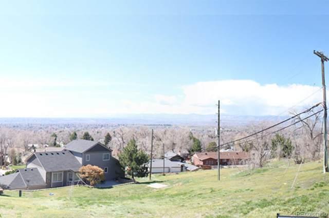 8780 W 68th Place, Arvada, CO 80004 (MLS #3166787) :: Neuhaus Real Estate, Inc.