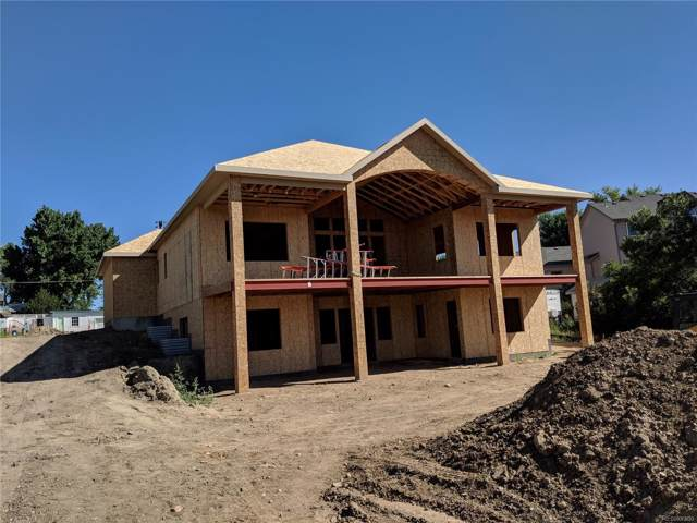10042 W 69th Place, Arvada, CO 80004 (#3167470) :: The Peak Properties Group
