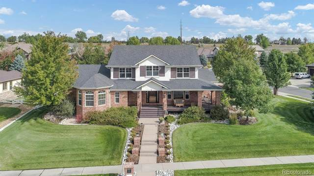 12823 W 80th Place, Arvada, CO 80005 (#3220933) :: Peak Properties Group