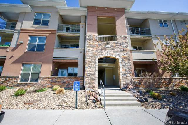 8133 W 51st Place #204, Arvada, CO 80002 (#3229843) :: The Healey Group