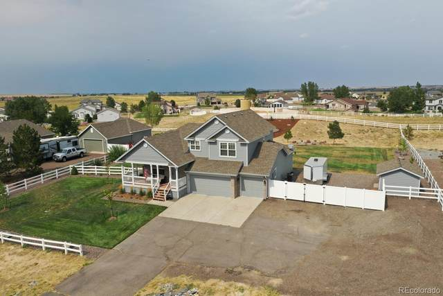 16580 Timber Cove Street, Hudson, CO 80642 (#3287797) :: The Brokerage Group