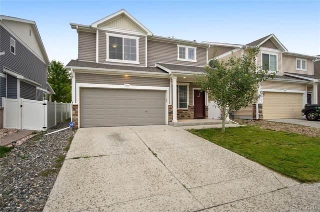 5554 Lisbon Street, Denver, CO 80249 (#3288646) :: Peak Properties Group