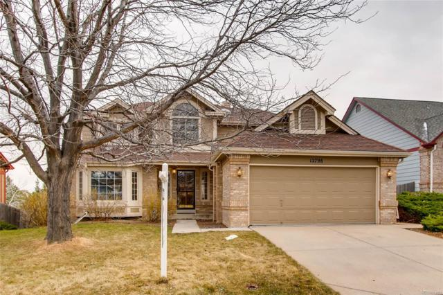 12798 W 84th Drive, Arvada, CO 80005 (#3306533) :: The Peak Properties Group