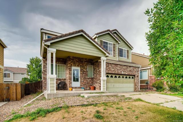 15721 E 96th Place, Commerce City, CO 80022 (#3358373) :: The Heyl Group at Keller Williams