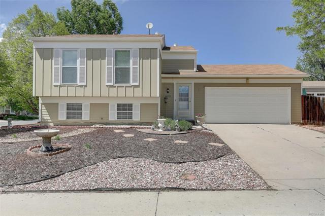 19909 E Batavia Drive, Aurora, CO 80011 (#3361622) :: Briggs American Properties