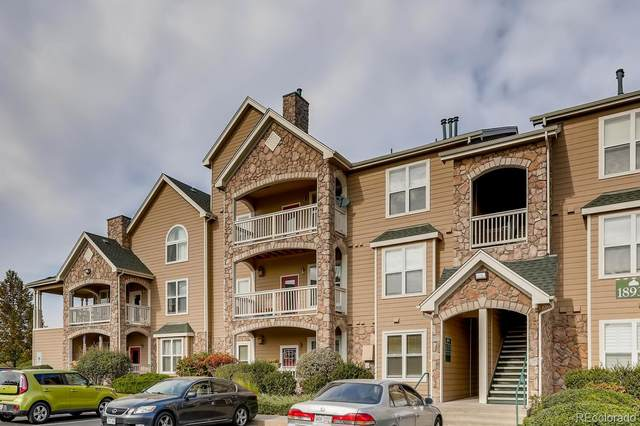 18939 E Warren Circle E-302, Aurora, CO 80013 (#3388353) :: Portenga Properties - LIV Sotheby's International Realty