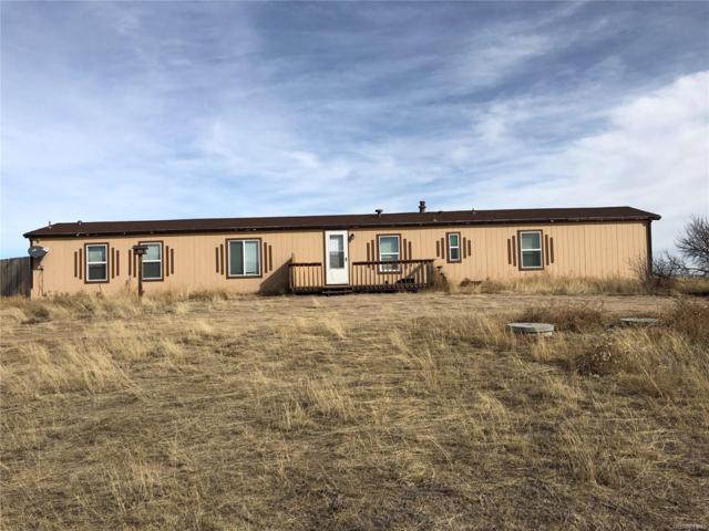 13335 Trail Boss Court, Peyton, CO 80831 (#3390437) :: Venterra Real Estate LLC