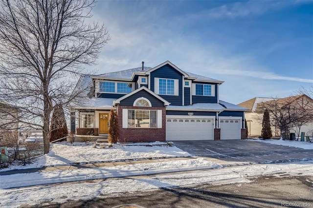 12714 W 77th Drive, Arvada, CO 80005 (#3406246) :: Chateaux Realty Group