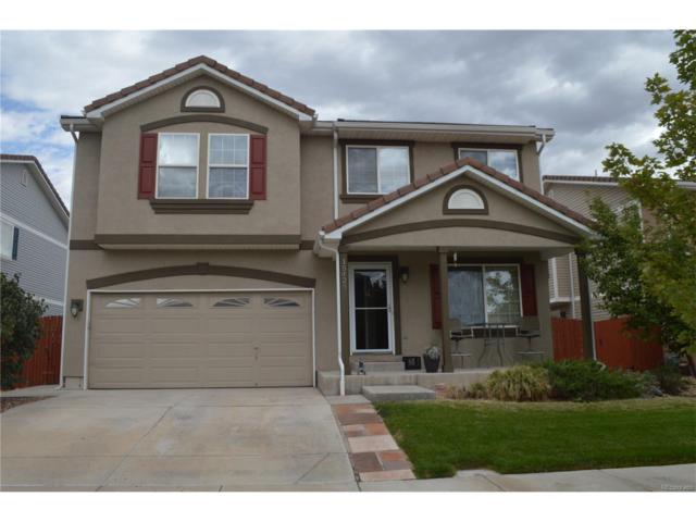 15423 E 98th Place, Commerce City, CO 80022 (#3439412) :: The Peak Properties Group