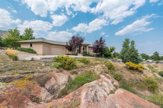 11220 Rock Wren, Littleton, CO 80125 (#3440341) :: Symbio Denver