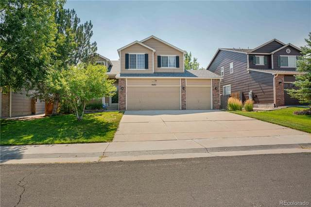 5682 S Versailles Street, Aurora, CO 80015 (#3450295) :: The DeGrood Team