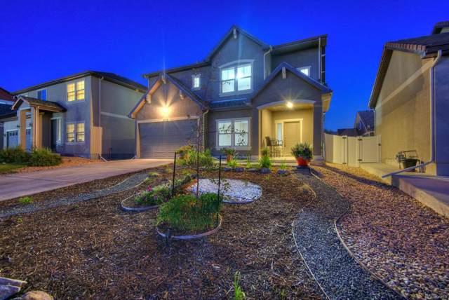 5326 Lisbon Street, Denver, CO 80249 (#3458106) :: 5281 Exclusive Homes Realty
