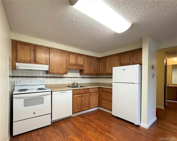 1300 S Parker Road #105, Denver, CO 80231 (#3469180) :: Portenga Properties