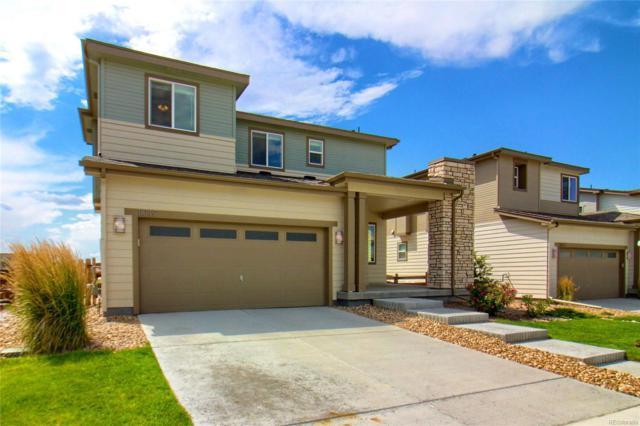 11049 Rifle Court, Commerce City, CO 80022 (#3472250) :: The Peak Properties Group